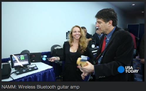 Starr Ackerman and Jefferson Graham from USA Today showing off iLoud bluetooth speaker system.